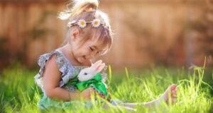 Cute-Girl-Playing-With-Rabbit-Pic