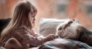 Cute-Girl-Playing-With-Rabbit-Image