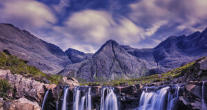 Waterfall-Under-Cloudy-Sky-HD-Image